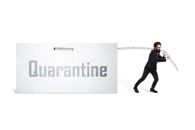 Caucasian businessman pulling inscription quarantine  on a white sheet, epidemic financial loss concept