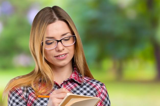 Caucasian businesswoman taking notes