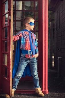 Caucasian children superhero and play shoot