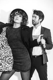 A caucasian couple in a black and white fashion shoot on valentine's day