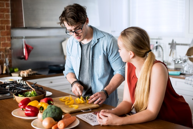 Caucasian couple cooking in the kitchen together