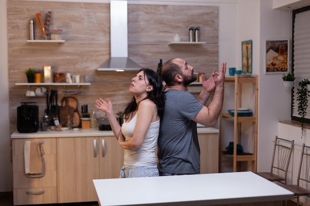 Caucasian couple having marriage problems and fighting