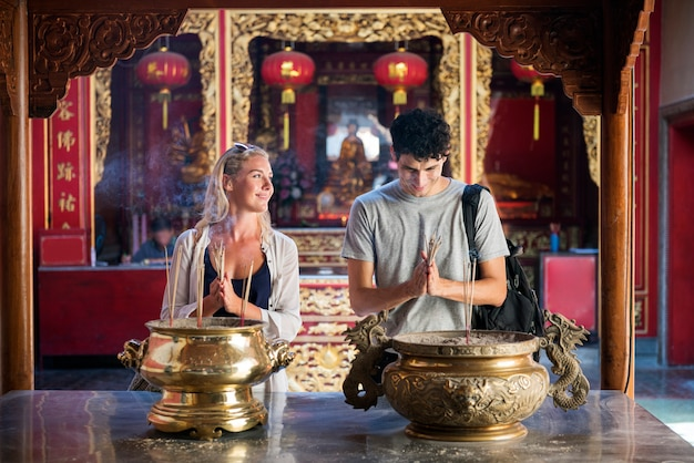 Caucasian couple is praying in the temple