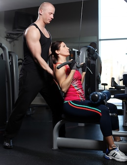 Caucasian couple posing in a gym