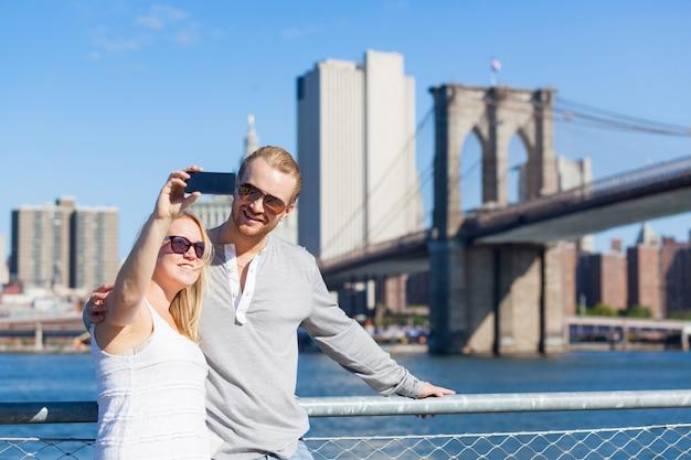 Caucasian couple taking selfie in new york
