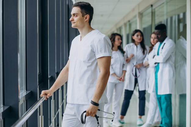 Caucasian doctor man standing in the corridor of the hospital
