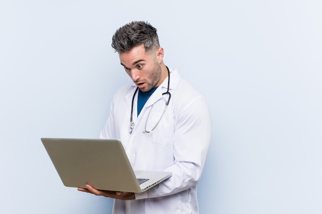 Caucasian doctor man with a laptop