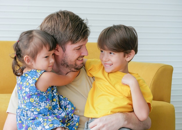 Caucasian father hug two kids ,son and daughter with love.