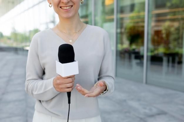 Caucasian female journalist outdoors