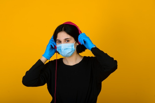 The caucasian girl in blue colored protective face mask. the girl. portrait shot. virus and pollution protection concept.