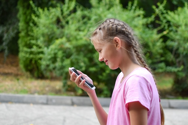 Caucasian girl with outdoor phone. internet communication by sms. online chat teenager.