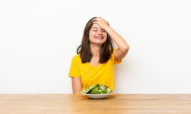 Caucasian girl with salad laughing