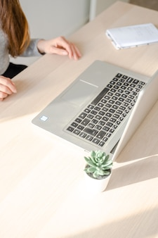 Caucasian girl working with a laptop on her desk in her office in palma de mallorca, spain