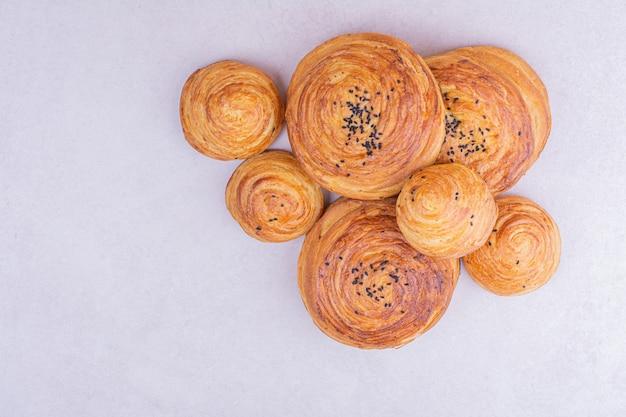 Caucasian gogal buns with cumin on grey.