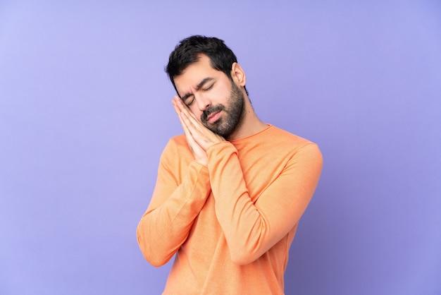 Caucasian handsome man making sleep gesture in dorable expression