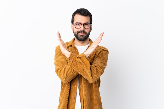 Caucasian handsome man with beard wearing a corduroy jacket over white making no gesture