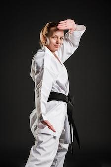 Caucasian karate woman posing medium shot