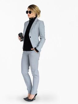 Caucasian lady wearing sunglasses holding coffee