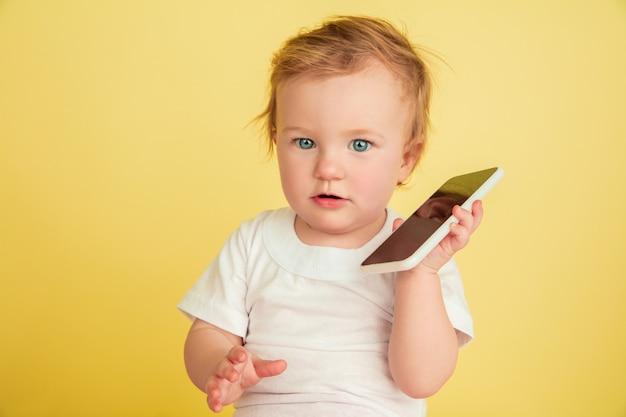 Caucasian little girl, children isolated on yellow