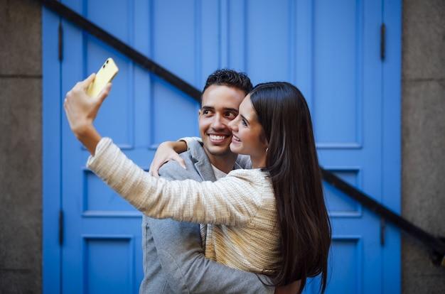 Caucasian loving couple doing a selfie