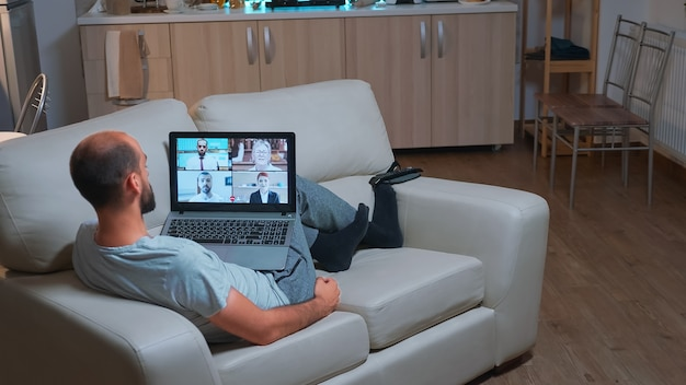 Caucasian male talking about business communication project during video call meeting