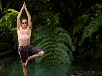 Caucasian man doing yoga in Bali