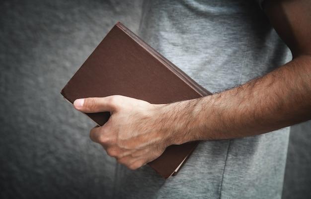 Caucasian man holding bible