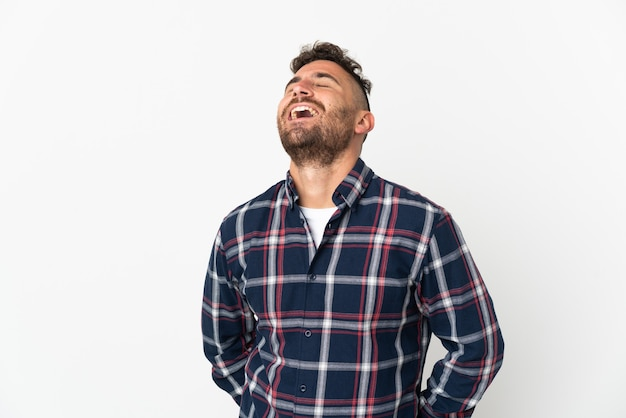 Caucasian man isolated on white background laughing