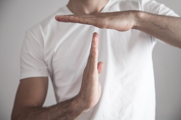 Caucasian man making time out gesture