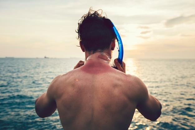 Caucasian man preparing for snorkeling