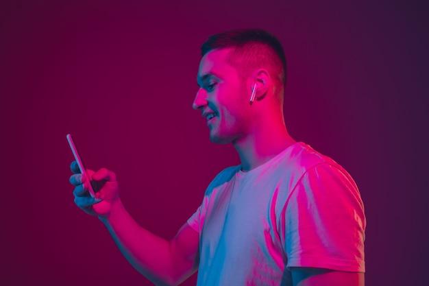 Caucasian man's portrait isolated  in neon light