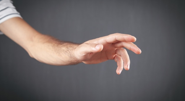 Caucasian man showing empty hand.