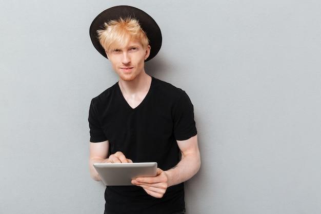 Caucasian man using tablet computer.