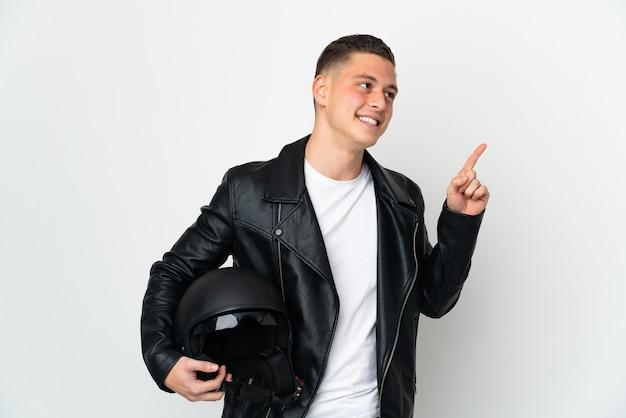 좋은 아이디어를 가리키는 흰색 배경에 고립 된 오토바이 헬멧 백인 남자