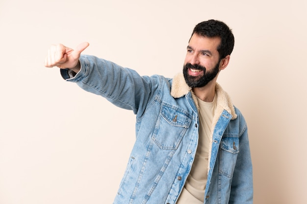 Caucasian man with beard over isolated background giving a thumbs up gesture