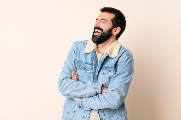 Caucasian man with beard over isolated background happy and smiling