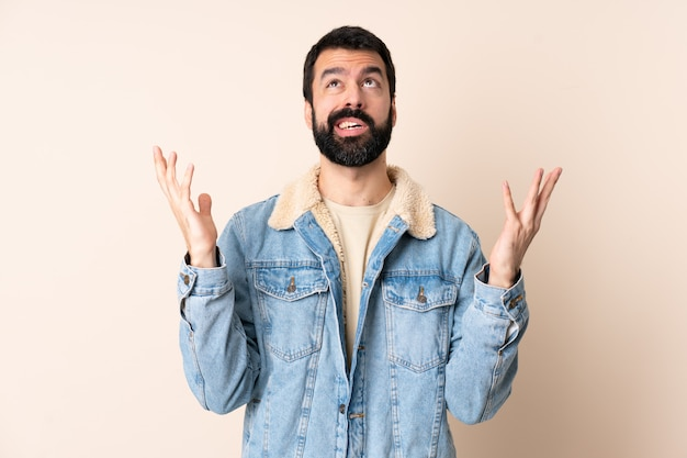 Caucasian man with beard over isolated stressed overwhelmed