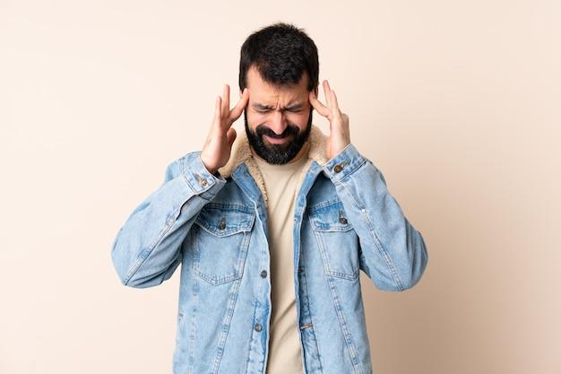 Caucasian man with beard on isolated with headache