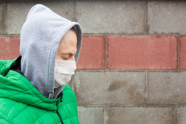Caucasian man with medical protective face mask illustrates pandemic coronavirus