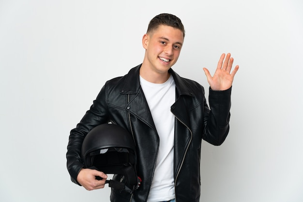 Caucasian man with a motorcycle helmet isolated
