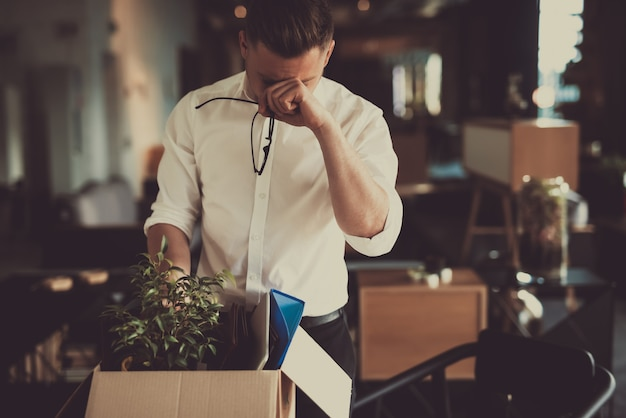 Caucasian manager leave workplace with office box