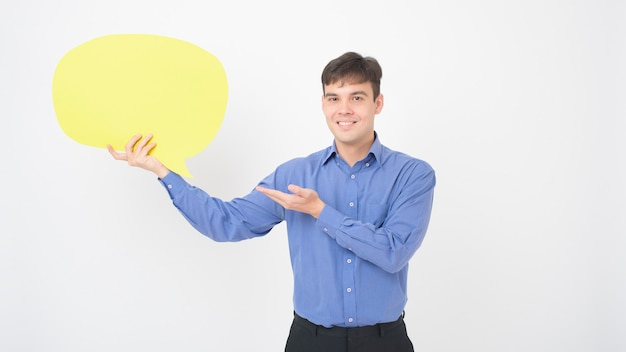 A caucasian middle aged man is holding yellow empty speech on white background