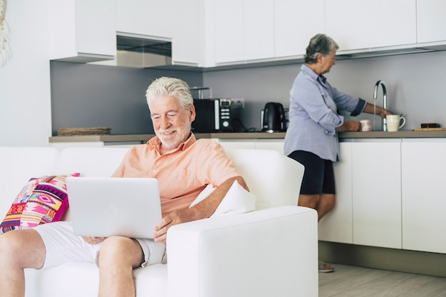 Caucasian people aged senior adult couple at home