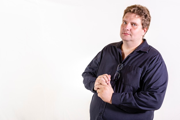 Caucasian plus size man isolated on white wall with copy space