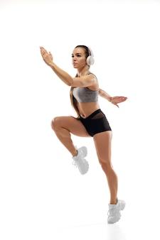Caucasian professional female runner, athlete training isolated on white studio Free Photo