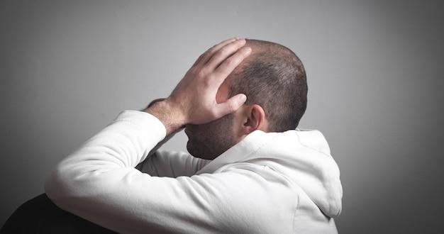 Caucasian sad and depressed man at home.