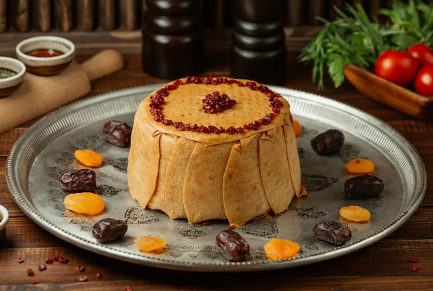 Caucasian shah plove with pomegranate seeds and dry fruits