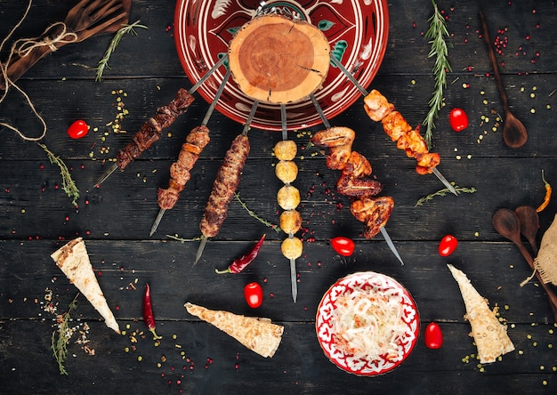 Caucasian shashlyq skewers with a variety of meat