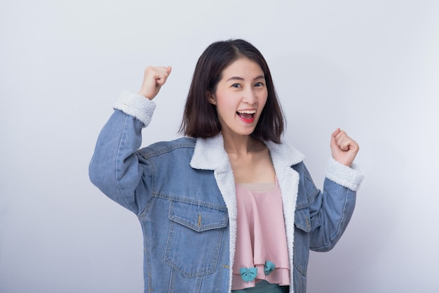 Caucasian smiling excited woman showing her hand with expression feeling surprised and amazed