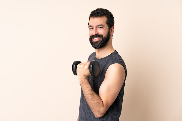 Caucasian sport man with beard making weightlifting isolated